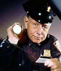 cop-with-flashlight